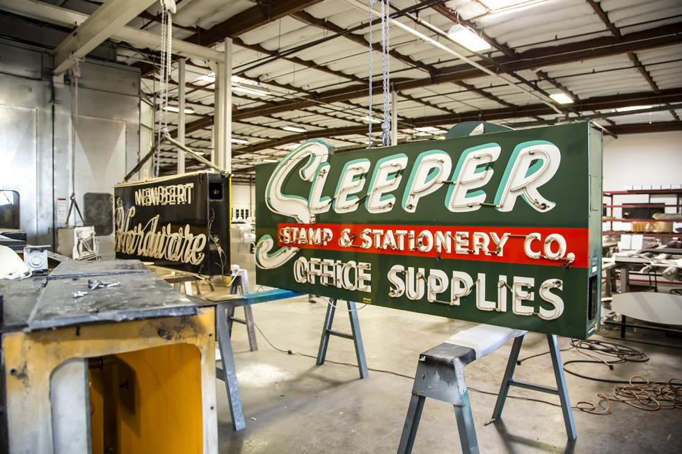 "Vintage neon signs sit on the floor of the Pacific Neon workshop after being delivered from the ""neon graveyard"" at the Center for Sacramento History. (Photos by Joan Cusick)"